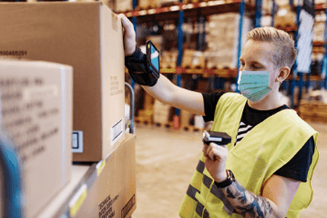 Warehouse employee scanning boxes Beyond brokerage
